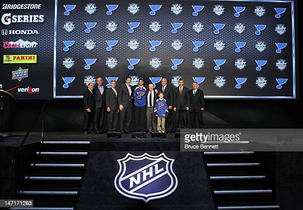 Jordan Schmaltz 25th overall pick by the St Louis Blues poses on stage with NHL Commissioner Gary Bettman and team representatives during Round One...