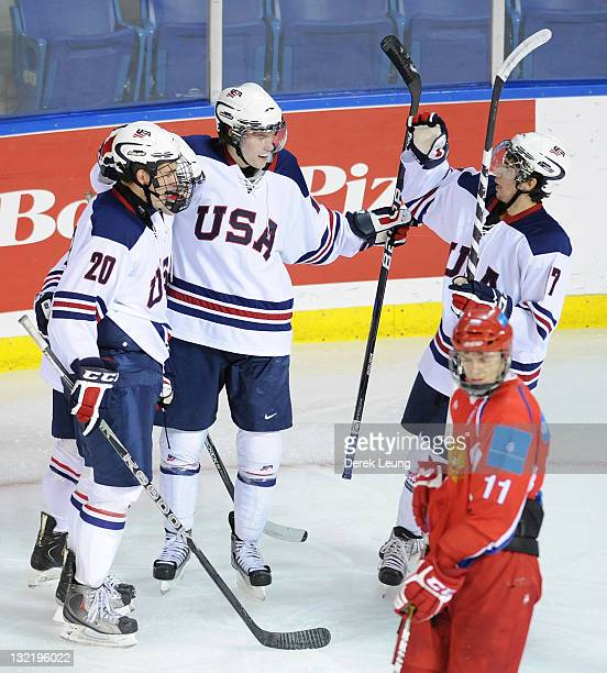 Jordan Schmaltz Ian McCoshen and Mario Lucia of USA celebrate after scoring a goal on Andrei Vasilevski of Russia at World Junior A Challenge at...