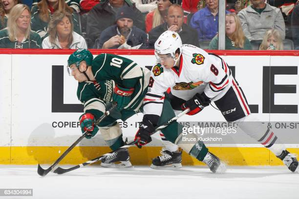 Jordan Schroeder of the Minnesota Wild and Nick Schmaltz of the Chicago Blackhawks battle for the puck along the boards during the game on February 8...