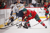 Jordan Schroeder of the Minnesota Wild is called for a hooking penalty against Nicolas Deslauriers of the Buffalo Sabres during the game on November...