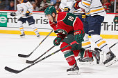 Jordan Schroeder of the Minnesota Wild skates to the puck against the Buffalo Sabres during the game on November 13 2014 at the Xcel Energy Center in...