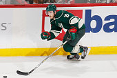 Jordan Schroeder of the Minnesota Wild skates with the puck against the Chicago Blackhawks in Game Four of the Western Conference Semifinals during...