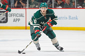 Jordan Schroeder of the Minnesota Wild skates with the puck against the Dallas Stars in Game Six of the Western Conference First Round during the...