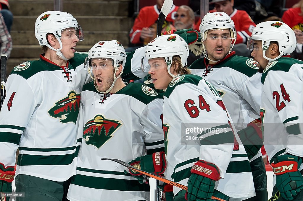<a gi-track='captionPersonalityLinkClicked' href=/galleries/search?phrase=Jordan+Schroeder&family=editorial&specificpeople=4450940 ng-click='$event.stopPropagation()'>Jordan Schroeder</a> #10 of the Minnesota Wild yells out with teammates <a gi-track='captionPersonalityLinkClicked' href=/galleries/search?phrase=Mike+Reilly+-+Ice+Hockey+Player&family=editorial&specificpeople=12893936 ng-click='$event.stopPropagation()'>Mike Reilly</a> #4, <a gi-track='captionPersonalityLinkClicked' href=/galleries/search?phrase=Mikael+Granlund&family=editorial&specificpeople=5649678 ng-click='$event.stopPropagation()'>Mikael Granlund</a> #64, <a gi-track='captionPersonalityLinkClicked' href=/galleries/search?phrase=Nino+Niederreiter&family=editorial&specificpeople=6667732 ng-click='$event.stopPropagation()'>Nino Niederreiter</a> #22 and Matt Dumba #24, after Niederreiter scored against the Chicago Blackhawks in the second period of the NHL game at the United Center on March 20, 2016 in Chicago, Illinois.