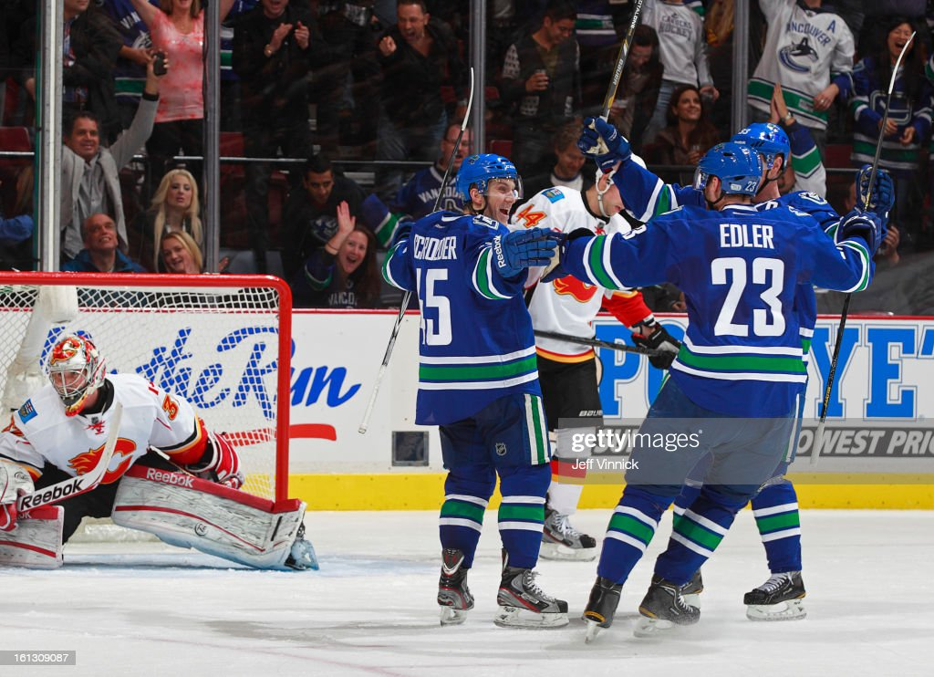 <a gi-track='captionPersonalityLinkClicked' href=/galleries/search?phrase=Jordan+Schroeder&family=editorial&specificpeople=4450940 ng-click='$event.stopPropagation()'>Jordan Schroeder</a> #45 of the Vancouver Canucks celebrates his furst NHL goal, scored against Leland Irving #37 of the Calgary Flames during their NHL game at Rogers Arena February 9, 2013 in Vancouver, British Columbia, Canada. Vancouver won 5-1.