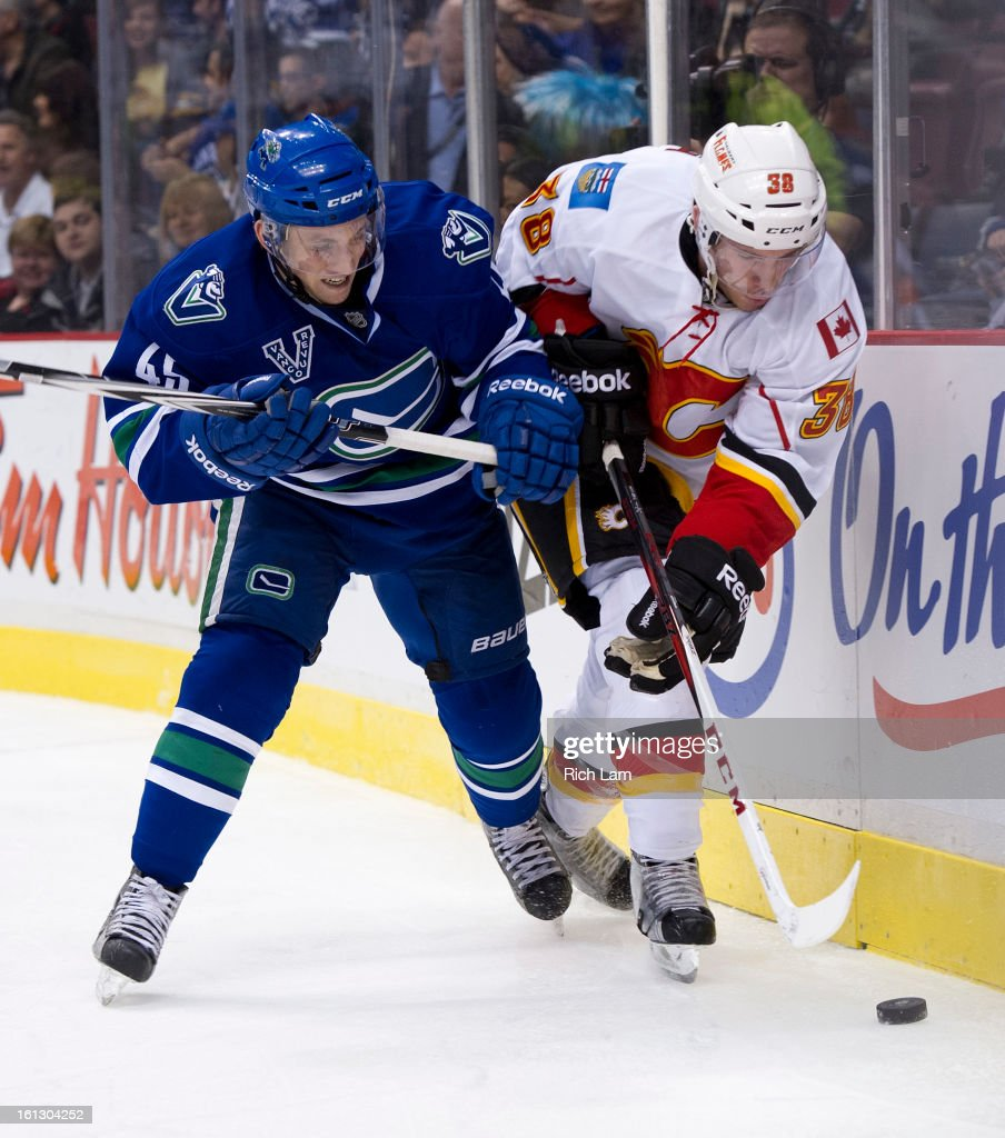 <a gi-track='captionPersonalityLinkClicked' href=/galleries/search?phrase=Jordan+Schroeder&family=editorial&specificpeople=4450940 ng-click='$event.stopPropagation()'>Jordan Schroeder</a> #45 of the Vancouver Canucks delivers a check to Ben Street #38 of the Calgary Flames during the third period in NHL action on February 09, 2013 at Rogers Arena in Vancouver, British Columbia, Canada.