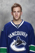 Jordan Schroeder of the Vancouver Canucks poses for his official headshot for the 201314 NHL season on September 11 2013 at Rogers Arena in Vancouver...