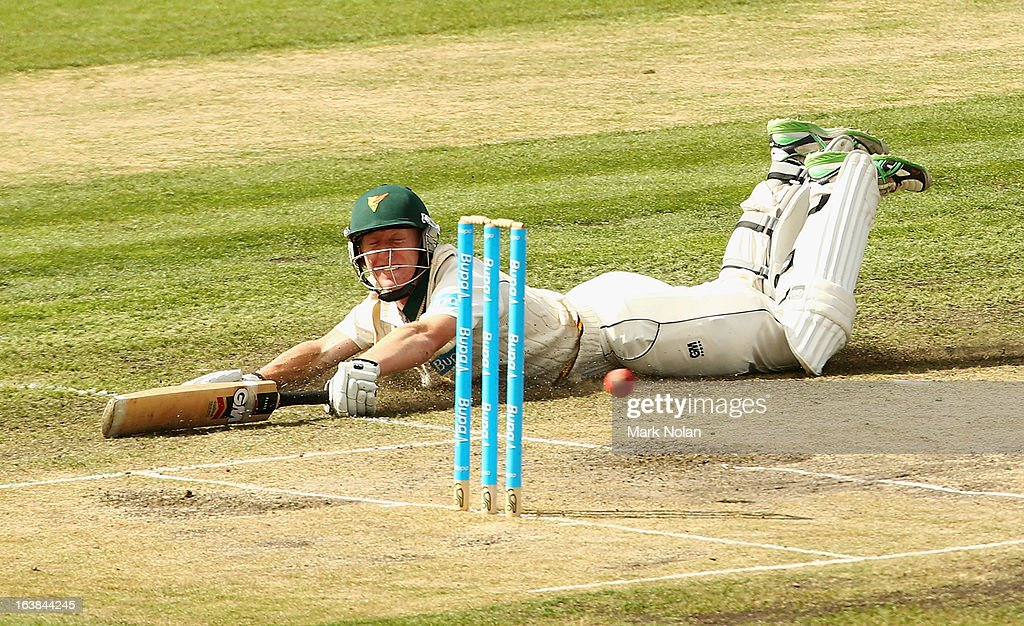 Jordan Silk of Tasmania dives to avoid being run out during day four of the Sheffield Shield match between the Tasmania Tigers and the Victoria Bushrangers at Blundstone Arena on March 17, 2013 in Hobart, Australia.