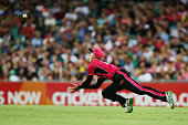 Jordan Silk of the Sixers takes a diving catch to dismiss Chris Green of the Thunder during the Big Bash League match between the Sydney Sixers and...