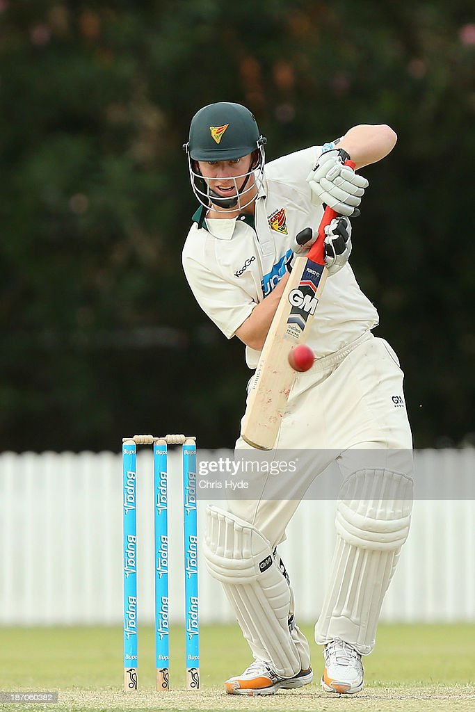 Jordan Silk of the Tigers bats during day one of the Sheffield Shield match between the Queensland Bulls and the Tasmania Tigers at Allan Border Field on November 6, 2013 in Brisbane, Australia.