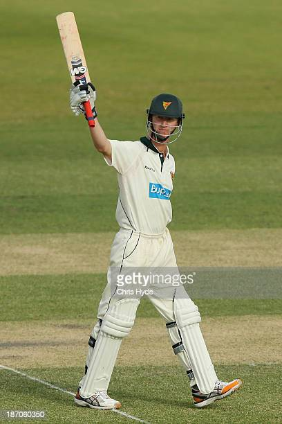 Jordan Silk of the Tigers celebrates his century during day one of the Sheffield Shield match between the Queensland Bulls and the Tasmania Tigers at...