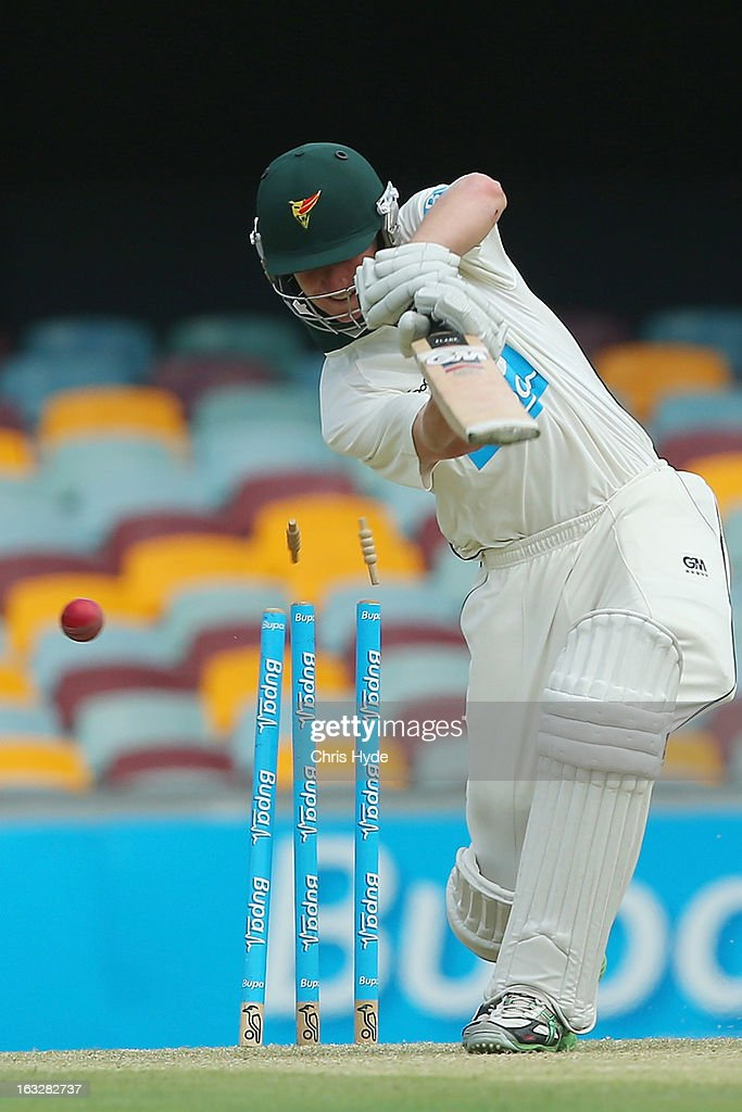 Jordan Silk of the Tigers is bowled out by Alister McDermott of the Bulls during day one of the Sheffield Shiled match between the Queenaland Bulls and the Tasmanian Tigers at The Gabba on March 7, 2013 in Brisbane, Australia.