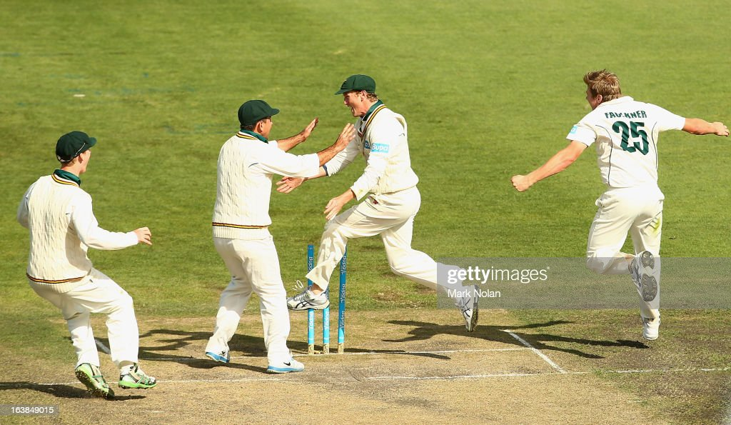 Jordan Silk, <a gi-track='captionPersonalityLinkClicked' href=/galleries/search?phrase=Ricky+Ponting&family=editorial&specificpeople=176564 ng-click='$event.stopPropagation()'>Ricky Ponting</a>, George Bailey and James Faulkner of Tasmania celebrate the run out of Cameron White of Victoria by Bailey during day four of the Sheffield Shield match between the Tasmania Tigers and the Victoria Bushrangers at Blundstone Arena on March 17, 2013 in Hobart, Australia.