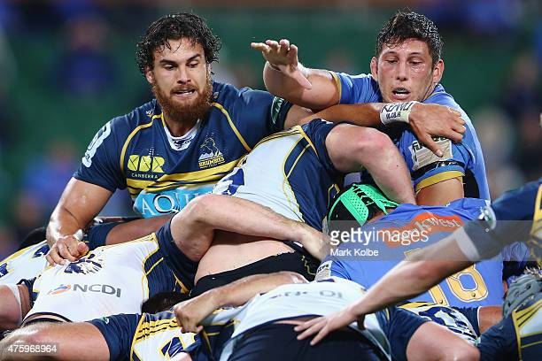 Jordan Smiler of the Brumbies and Adam Coleman of the Force watch on as the maul forms around them during the round 17 Super Rugby match between the...