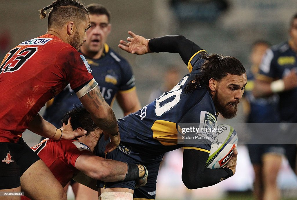 Jordan Smiler of the Brumbies is tackled during the round 14 Super Rugby match between the Brumbies and the Sunwolves at GIO Stadium on May 28, 2016 in Canberra, Australia.