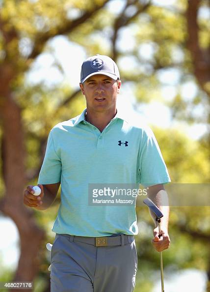 Jordan Spieth acknowledges the crowd after making a birdie putt on the first hole during the final round of the Valero Texas Open at TPC San Antonio...
