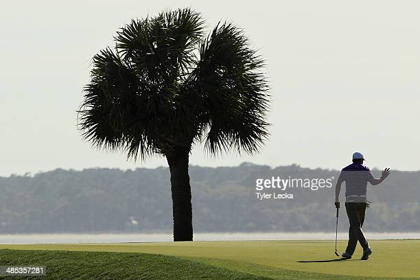 Jordan Spieth acknowledges the gallery on the 17th green during the first round of the RBC Heritage at Harbour Town Golf Links on April 17 2014 in...
