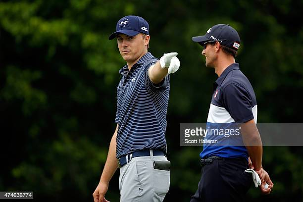 Jordan Spieth and Adam Scott of Australia walk the 5th fairway during the final round of the Crowne Plaza Invitational at the Colonial Country Club...