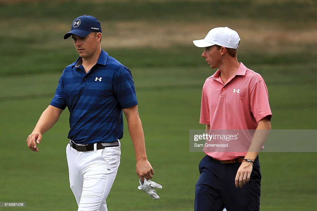 Jordan Spieth and amateur Lee McCoy walk down the first fairway during the final round of the Valspar Championship at Innisbrook Resort Copperhead Course on March 13, 2016 in Palm Harbor, Florida.