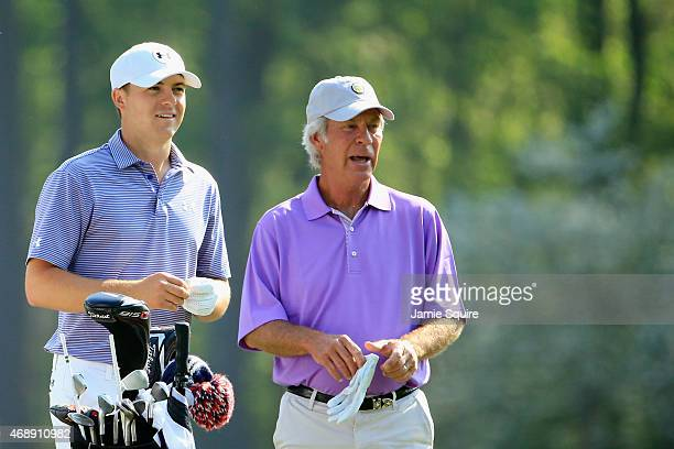 Jordan Spieth and Ben Crenshaw of the United States wait together during a practice round prior to the start of the 2015 Masters Tournament at...