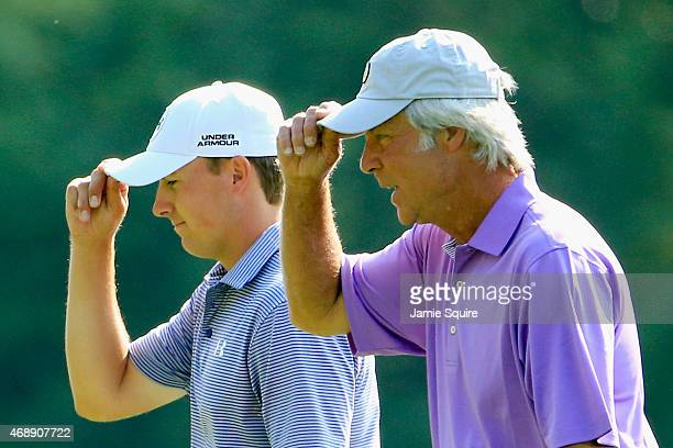 Jordan Spieth and Ben Crenshaw of the United States walk together during a practice round prior to the start of the 2015 Masters Tournament at...