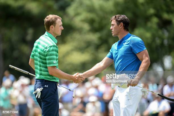 Jordan Spieth and Brooks Koepka shake hands following their 1st round action at the PGA Championship at the Quail Hollow Club on August 10 2017 in...