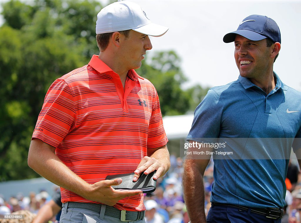 Jordan Spieth and Charl Schwartzel talk after teeing off on the tenth hole during the second day of the Dean & DeLuca Invitational Golf Tournament at the Colonial Country Club on May 27, 2016 in Fort Worth, Texas.