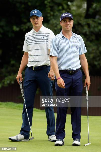 Jordan Spieth and Justin Thomas of the United States stand on the tenth green during round two of The Northern Trust at Glen Oaks Club on August 25...