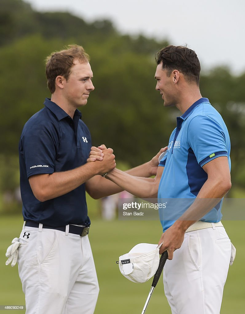 Jordan Spieth and Martin Kaymer of Germany shake hands on the 18th hole green following the third round of THE PLAYERS Championship on THE PLAYERS Stadium Course at TPC Sawgrass on May 10, 2014 in Ponte Vedra Beach, Florida.
