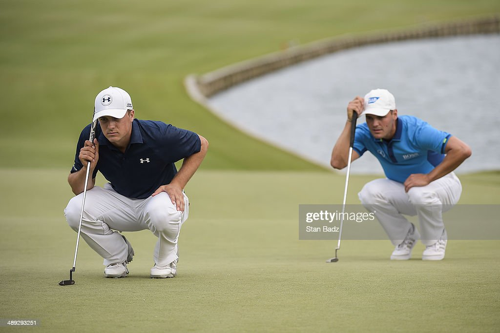 Jordan Spieth and Martin Kaymer of Germany study the 18th hole green during the third round of THE PLAYERS Championship on THE PLAYERS Stadium Course at TPC Sawgrass on May 10, 2014 in Ponte Vedra Beach, Florida.