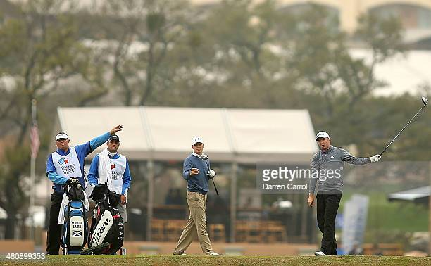 Jordan Spieth and Martin Laird prepare to tee off on the 11th during Round One of the Valero Texas Open at the ATT Oaks Course on March 27 2014 in...