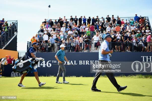 Jordan Spieth and Matt Kuchar of the United States walk off the first tee during the final round of the 146th Open Championship at Royal Birkdale on...