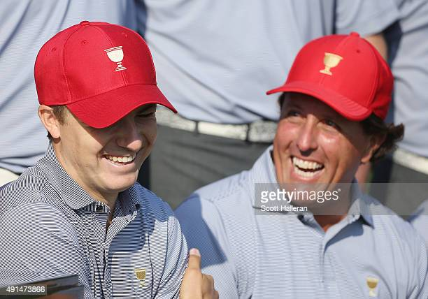 Jordan Spieth and Phil Mickelson of the United States team pose with his team during a photocall prior to the start of The Presidents Cup at the Jack...