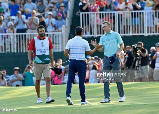 Jordan Spieth and Rickie Fowler shake hands after the third round of THE NORTHERN TRUST at Glen Oaks Club on August 26 in Old Westbury New York