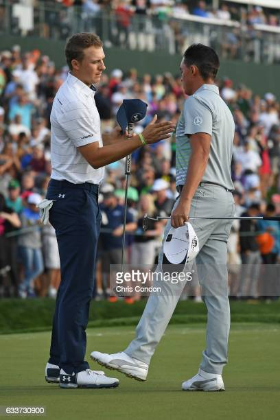 Jordan Spieth and Rickie Fowler shake hands on the 18th green during the second round of the Waste Management Phoenix Open at TPC Scottsdale on...