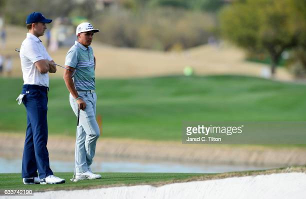 Jordan Spieth and Rickie Fowler stand on the 15th green during the second round of the Waste Management Phoenix Open at TPC Scottsdale on February 3...