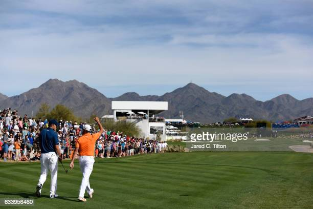 Jordan Spieth and Rickie Fowler walk the 17th fairway during the final round of the Waste Management Phoenix Open at TPC Scottsdale on February 5...