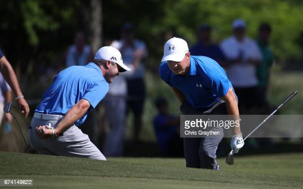 Jordan Spieth and Ryan Palmer react to their shot on the 14th hole during the first round of the Zurich Classic at TPC Louisiana on April 27 2017 in...
