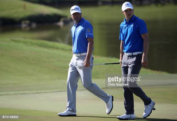 Jordan Spieth and Ryan Palmer react to their shot on the 17th hole during the first round of the Zurich Classic at TPC Louisiana on April 27 2017 in...
