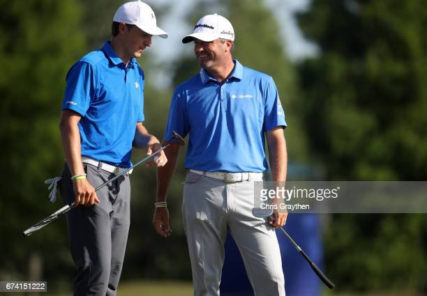 Jordan Spieth and Ryan Palmer react to their shot on the 18th hole during the first round of the Zurich Classic at TPC Louisiana on April 27 2017 in...