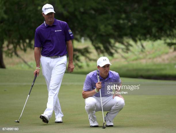 Jordan Spieth and Ryan Palmer wait to putt on the fifth hole during the third round of the Zurich Classic at TPC Louisiana on April 29 2017 in...