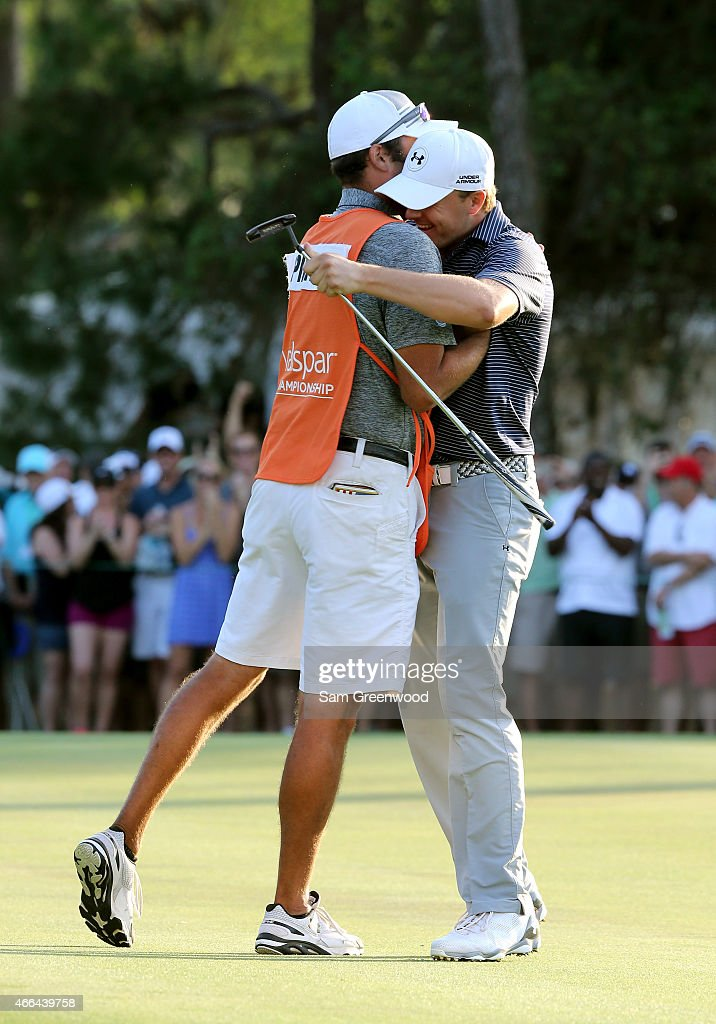 Jordan Spieth celebrates with his caddie Michael Greller after a birdie putt on the third playoff hole to win the Valspar Championship during the final round at Innisbrook Resort Copperhead Course on March 15, 2015 in Palm Harbor, Florida.