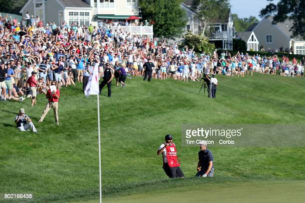 Jordan Spieth celebrates with his caddie Michael Greller after holing his sand trap shot on the eighteenth the first play off hole to win the...