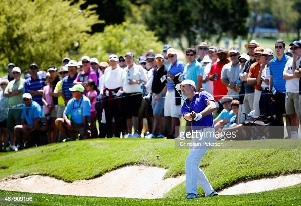 Jordan Spieth chips onto the eighth hole during round three of the Valero Texas Open at TPC San Antonio ATT Oaks Course on March 28 2015 in San...