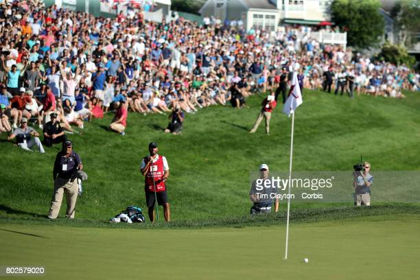 Jordan Spieth chips out of a sand trap on the eighteenth to set up a par save and force a play off during the fourth round of the Travelers...
