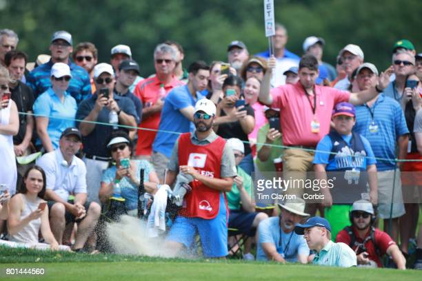 Jordan Spieth chips out of a sand trap on the fifth during the third round of the Travelers Championship Tournament at the TPC River Highlands Golf...