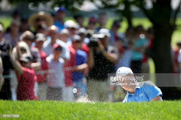 Jordan Spieth chips out of the sand trap on the ninth during day one of the Travelers Championship Tournament at the TPC River Highlands Golf Course...