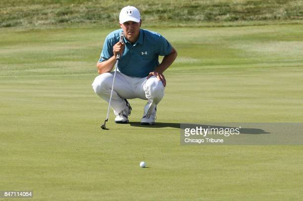 Jordan Spieth eyes a putt on the 16th green during the first round of the BMW Championship on Thursday Sept 14 at Conway Farms Golf Club in Lake...