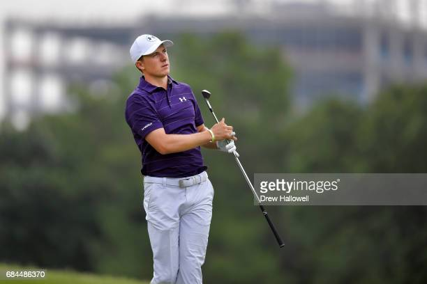 Jordan Spieth follows his second shot on the 15th hole during Round One of the ATT Byron Nelson at the TPC Four Seasons Resort Las Colinas on May 18...