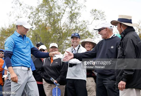 Jordan Spieth gives a signed glove to a fan after hitting him with an erant shot during round one of the Valero Texas Open at TPC San Antonio ATT...